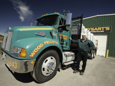 photo of man standing next to dysart's service wood pellets truck